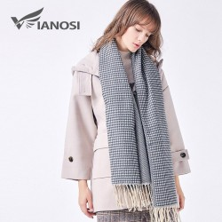 Elegant warm scarf with tassels